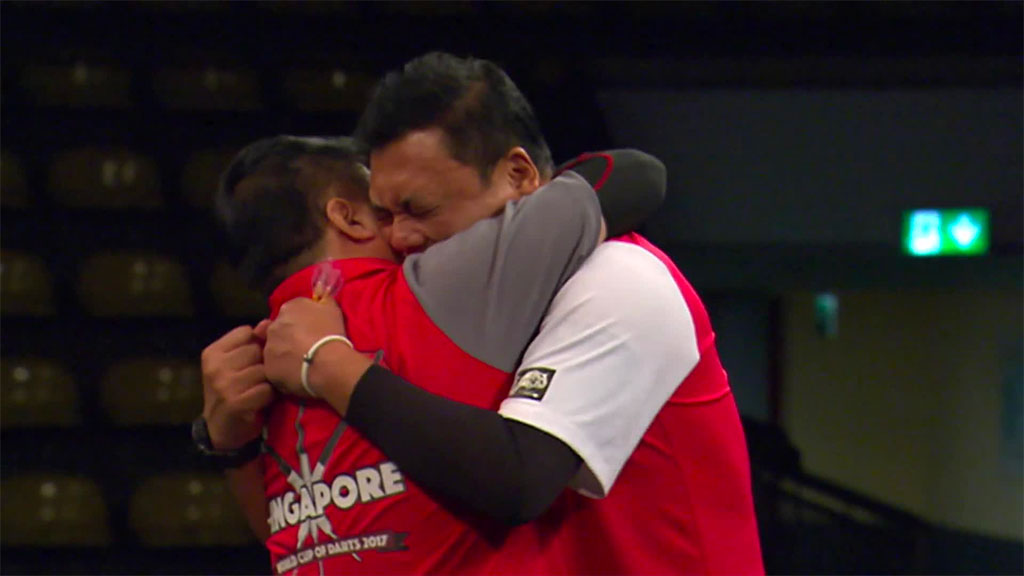 Singapore celebrate their shock win over Scotland in the opening night of the 2017 PDC World Cup of Darts. Photo Credit: Sky Sports.